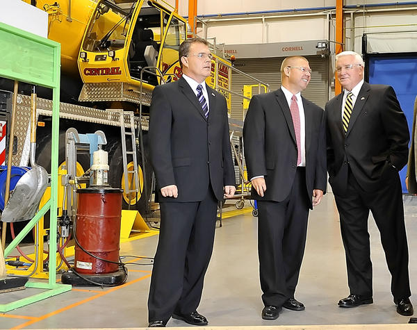 In this Hearld-Mail file photo, Pa. Rep. Todd Rock, left, Sen. Rich Alloway, center, and Pennsylvania Gov. Tom Corbett talk after a tour at Manitowoc Cranes. Alloway and Rock announced changes to their Franklin County, Pa., offices Wednesday.