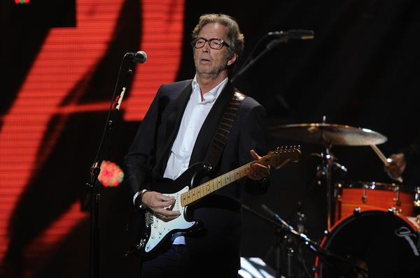 Eric Clapton performs at the 12-12-12 concert.