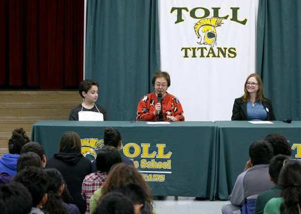 Kid's Resource founder Gerry Orz, 10, left, State Sen. Carol Liu, center, and Peace Over Violence's Emily Austin, right, celebrated California Bullying Prevention Day at Toll Middle School. Orz, who was bullied in elementary school, did not speak but played a recording of his voice encouraging everyone to play a role in stopping bullying.