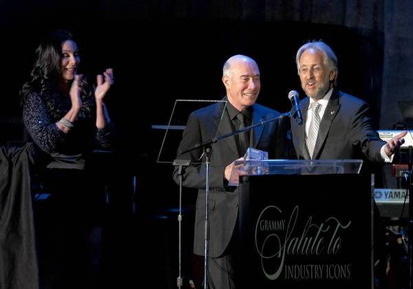 David Geffen, middle, receives an award from Cher, left, and Neil Portnow of the Recording Academy at a pre-Grammy gala in 2011.