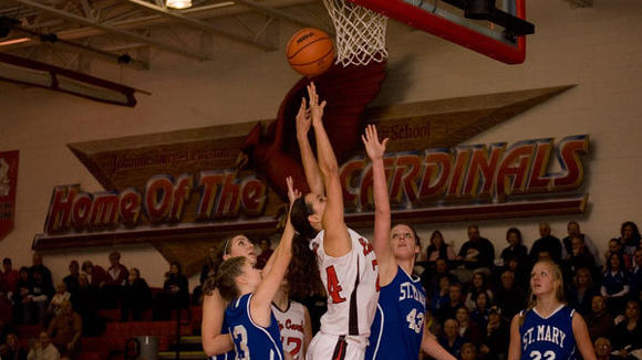 Cardinal senior Hannah Huff reaches for a rebound in Wednesday's 50-48 J-L victory over the Snowbirds.