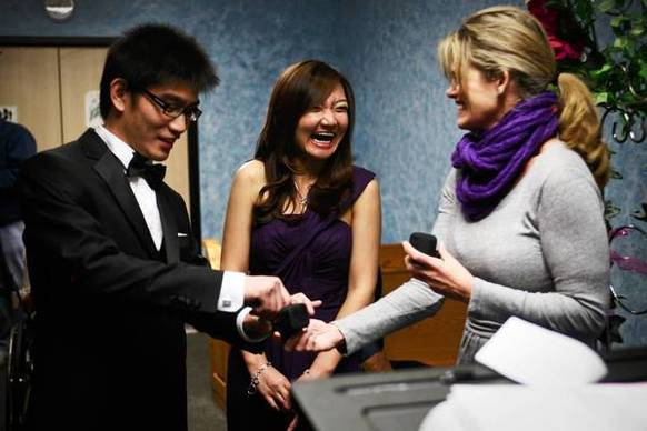 Peter Chen and Winnie Liu were among the couples to wed at the county clerks office in Norwalk on Dec. 12, 2012. At right is Karalynn Sprouse, Liu's friend and witness.