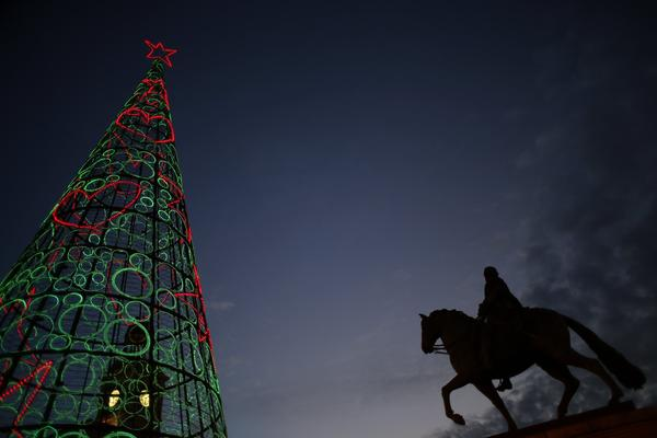 A Christmas tree made out of lights is seen at Madrid's landmark Puerta del Sol square December 12, 2012.