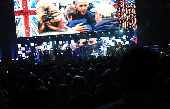 A video of President Barack Obama with victims of Superstorm Sandy plays in Madison Square Garden as The Who perform on Wednesday.