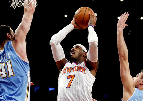 Carmelo Anthony (7) scored 34 points against the Denver Nuggets, his former team, on Sunday night.