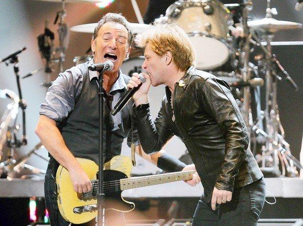 Bruce Springsteen, left, and Jon Bon Jovi team up at the 12-12-12 Sandy benefit concert at Madison Square Garden in New York.
