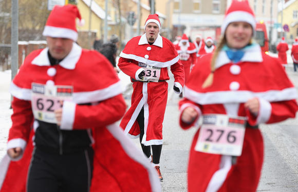 Participants dressed as Santa Claus jog to get ready before the 4th annual Michendorf Santa Run (Michendorfer Nikolauslauf) on December 9, 2012 in Michendorf, Germany.
