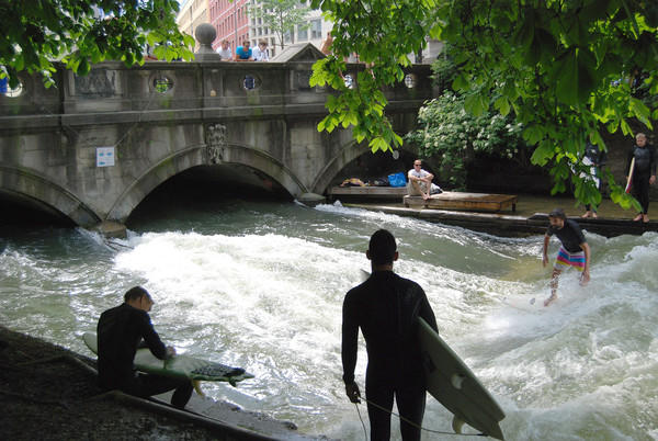 I live in Catonsville, MD and took this picture in Munich in May. I was travelling in Germany with my son. On this day, we were biking around Munich and came upon these surfers riding a man-made wave in The Eisbach, a small canal located in the Englischen Gardens. Most surfers were wearing wet suits due to the cold water, with the exception of this brave guy in the striped shorts.