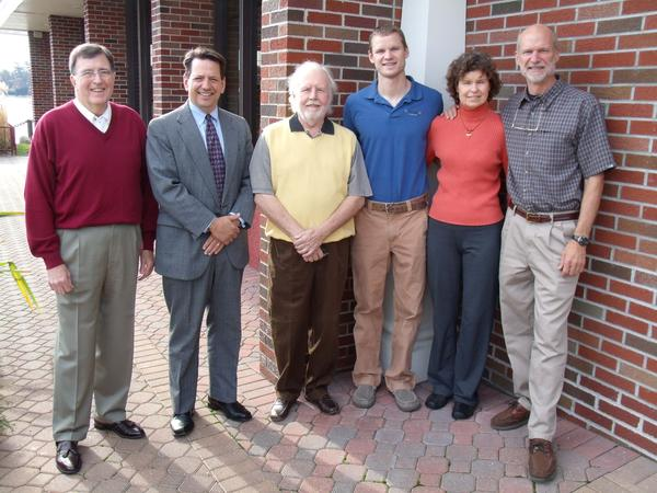 Tip of the Mitt SCORE chairman Bill Collins (from left) gathers with First Community Bank vice president of marketing Bill Savard and Tip of the Mitt SCORE business counselor Stephen Billings to recognize Ben, Jean and Steve VanDam of VanDam Custom Boats, a Boyne City-based company receiving the inaugural First Community Bank SCORE Award.