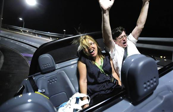 Angie and Patrick Manteiga of Tampa enjoy the fastest part of Test Track during the ride's grand opening last week.