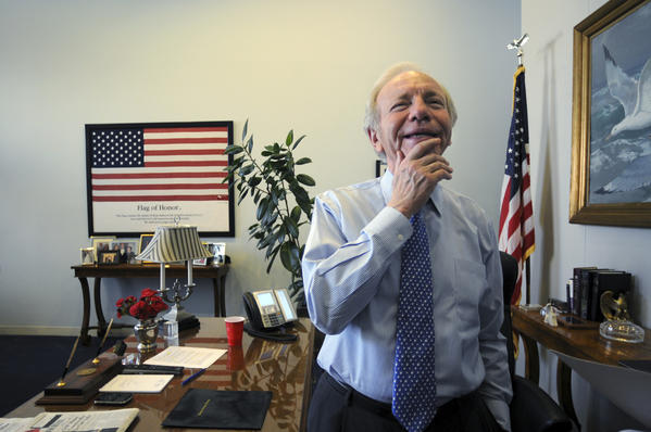 WASHINGTON, DC 12/04/12 Sen. Joseph I. Lieberman pauses during a conversation with an aid in his Washington, D.C. senate office recently.  Lieberman is in the closing days of his 24-year career as a U.S. senator from Connecticut.