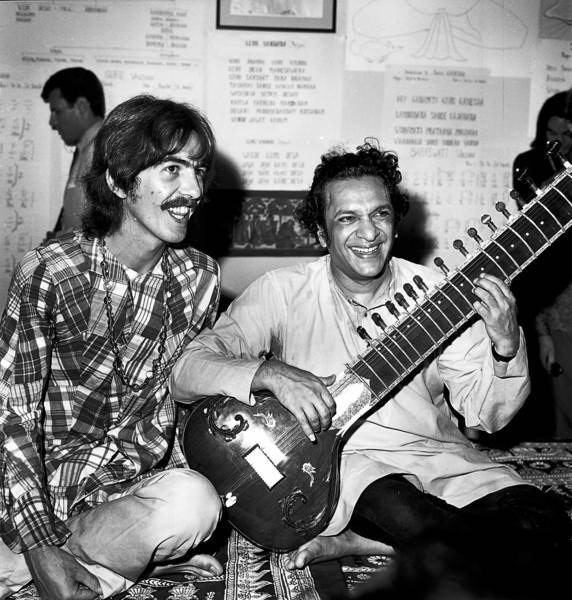 Sitarist Ravi Shankar, right, in a 1967 file photo with Beatles guitarist George Harrison.