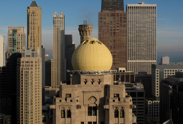 A man trying to take a photo from the top of the Intercontinental Hotel on Michigan Avenue fell 22 feet down a smokestack and died, according to authorities.