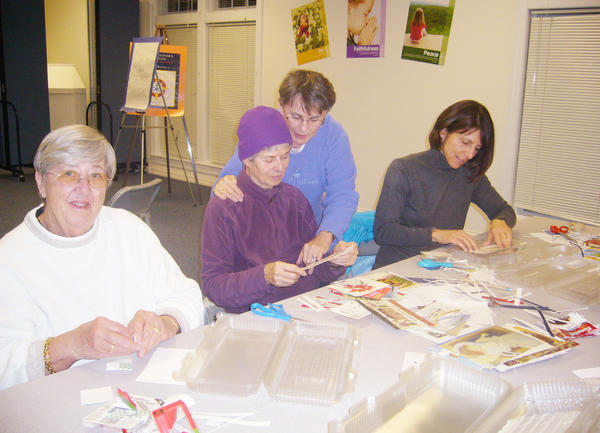Yvonne DeWindt (from left), Carol Smith, Sally Bouton and Laurie Ford prepare the cookie boxes for the cookie walk the First Presbyterian Church in Harbor Springs is sponsoring. The walk takes place from 9-11 a.m. Saturday, Dec. 15, at the church. All proceeds go to supporting community service agencies in Emmet County.