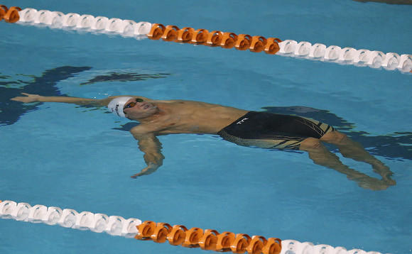 Matt Grevers winning the 100 backstroke at November's U.S. short course championships. (Ronald Martinez / Getty Images)