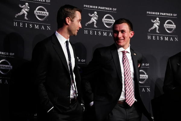 ffensive Coordinator/Quarterbacks Kliff Kingsbury quarterback Johnny Manziel of the Texas A&M University Aggies pose after being named the 78th Heisman Memorial Trophy Award winner at a press conference at the Marriott Marquis on December 8, 2012 in New York City. (Photo by Mike Stobe/Getty Images)