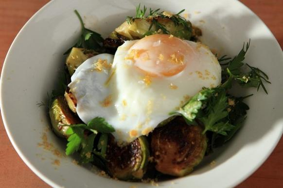 At Sqirl, breakfast can be roasted Brussels sprouts, mixed greens, Chicharron crumbs and a poached egg.