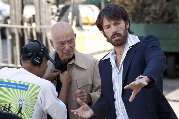 "Alan Arkin and and director Ben Affleck on the set of the movie ""Argo."""