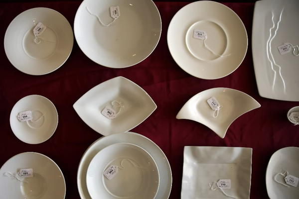 Serving dishes tagged during the auction at Charlie Trotter's, 816 W. Armitage Ave., on Wednesday. The auction consisted of about 1,500 lots including stemware, dinnerware, kitchen equipment, chairs, tables and artwork.