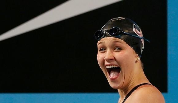 Olivia Smoliga reacts to winning the 100 back world title Thursday. (Murad Sezer / Reuters)