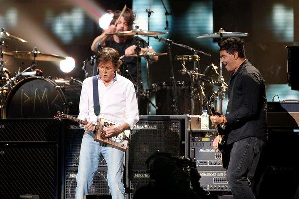"Paul McCartney, left, jams with drummer Dave Grohl and guitarist Pat Smear at ""121212: The Conc"