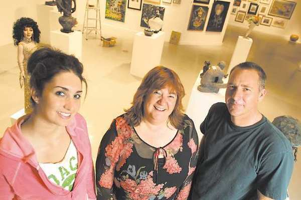"Huntington Beach Art Center director Darlene DeAngelo is flanked by artists Krista Thompson and Steve Schmidt in preparation for the ""Centered on the Center,"" exhibit in January 2004. DeAngelo stepped down from her post in September."