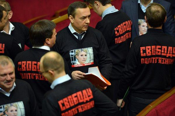 "Ukrainian opposition deputies wear sweaters featuring a portrait of jailed former Prime Minister Yulia Tymoshenko during the opening ceremony of the newly elected parliament in Kiev. On the back, the sweaters say, ""Free political prisoners!"""
