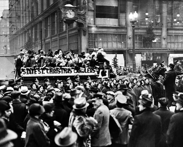 Frantic shoppers on Christmas Eve in 1935 paused at State and Madison Streets to listen to horse-drawn carolers that were making a tour of the Loop.