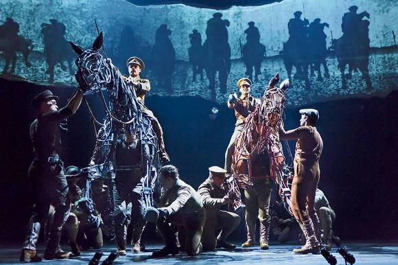 "Grayson DeJesus on Topthorn and Michael Wyatt Cox on Joey in ""War Horse."""