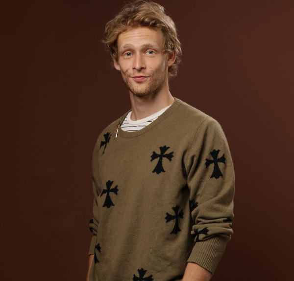 "Johnny Lewis, an actor who appeared in the TV show ""Sons of Anarchy,"" was found dead in a driveway, according to Los Angeles Police. Lewis was the suspect in a murder case."