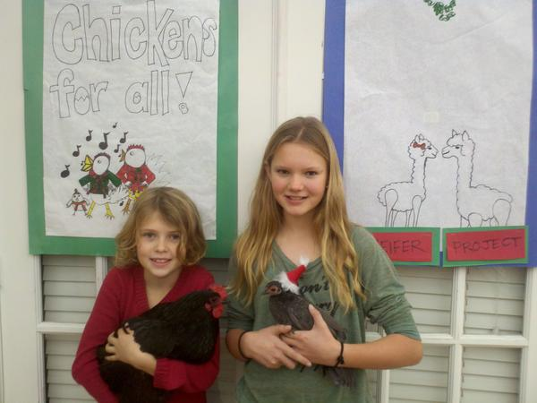 Clara and Lucinda Becker brought their pet chickens to Hospitality Night to raise awareness for Heifer International.