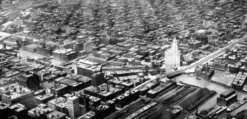 In this 1922 aerial of Chicago's downtown, the only tall building is the Wrigley Building and Rush Street still had a small bridge, behind the Wrigley Building, that spanned the Chicago River.