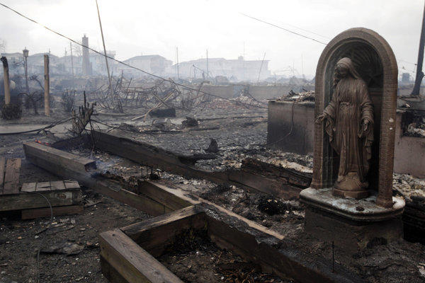 A fire sparked by Superstorm Sandy ripped through the Breezy Point area of Queens in New York. Scientists say the powerful punch of such storms will be more commonplace with climate change.