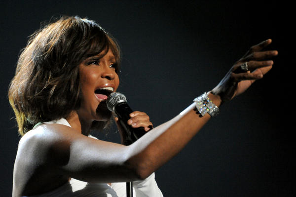 "Whitney Houston died at the age of 48 on Feb. 11, 2012. Perhaps best known for her version of Dolly Parton's ""I Will Always Love You,"" Houston had a decades long career that was not without its share of controversy."