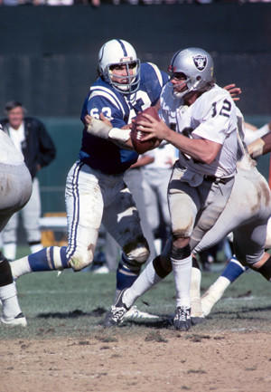 Baltimore Colts defensive tackle Mike Barnes chases Oakland Raiders quarterback Ken Stabler in a 1975 game at Memorial Stadium.