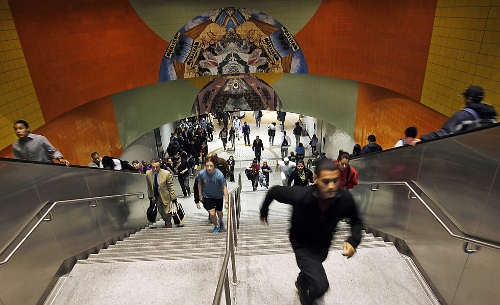 Commuters stream through North Hollywood's Metro Red Line Station, the creation of which helped the arts district take off in a big way. (Luis Sinco / Los Angeles Times)