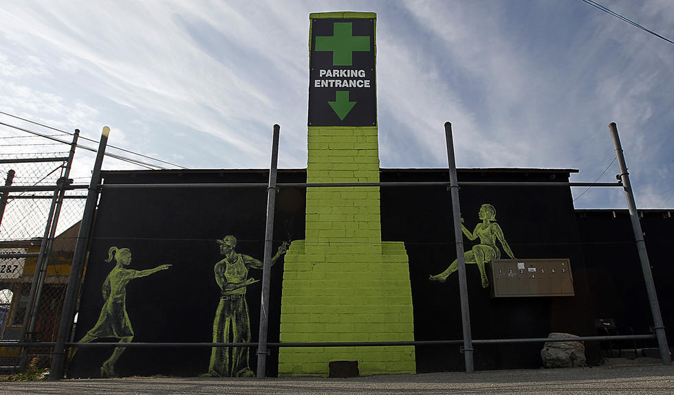 The pot shops that dot the northern half of Lankershim have added their own bit of branding to the landscape, with bold graphics, green signage and those telltale crosses. (Luis Sinco / Los Angeles Times)