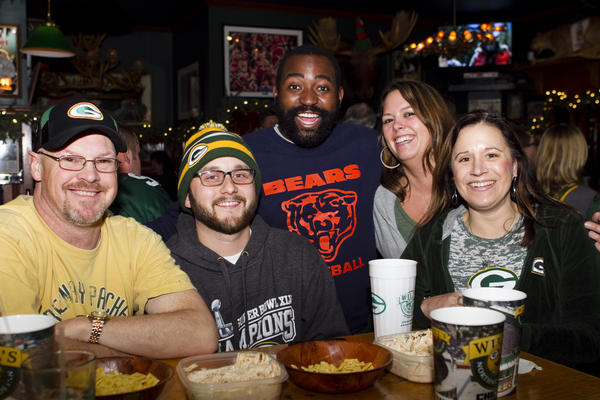 Bears fan and Chicago's wingman Ernest Wilkins (center), watched a recent Packers-Lions game with Green Bay fans at Will's Northwoods Inn in Lakeview, including Remy Billups (from left), Nate Meyers, Molly Feeney and Kim Gerrard.
