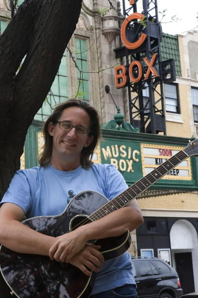 "Ralph Covert started out as founder, guitarist and vocalist of the Chicago indie band The Bad Examples. In 1995, he was caught in a weak moment. <Br><br> ""My oldest daughter was born in '95, so I started touring less,"" Covert said. ""The folks at the Old Town School (of Folk Music) asked if I wanted to do a Wiggleworms class,"" a program that introduces babies and toddlers to music. He was persuaded, and his music morphed to ""kindie rock,"" Covert said with a laugh. <Br><br> Although The Bad Examples earned Covert a level of fame, booking 200 shows a year in Europe and the States at one point, he now plays most often with Ralph's World, a kids' music band that evolved after his time doing Wiggleworms classes. <Br><br> Covert has also initiated a monthly series in which he plays alongside aspiring musicians -- kids and adults alike -- called Ralph Covert's Acoustic Army, which takes place on a Friday or Saturday night each month at FitzGerald's in Berwyn. Playing for children has taught Covert that gauging reactions, which kids have so readily, is the key to knowing how to hook an audience. <Br><br> ""My job as band leader is to take the pulse of the audience and go on a journey with them,"" Covert said. ""Some crowds want to dance more and some want to listen more."""