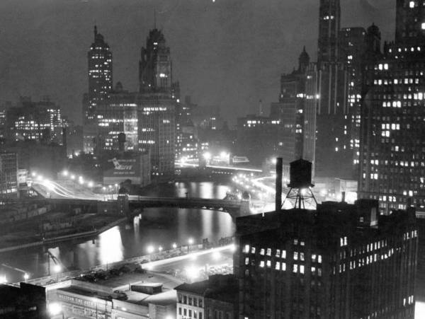 The outdoor lights are not on at the Wrigley Building, middle left, in this evening view, looking east, in 1945.