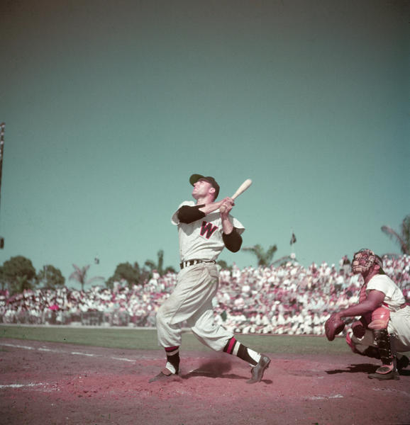 American baseball player Eddie Yost, in the uniform of the Washington Senators, follows through on a ball in the 1950s.