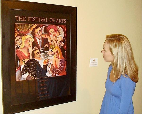 "A visitor checks out Sandra Jones Campbell's ""Card Trick and Table Twelve"" poster."