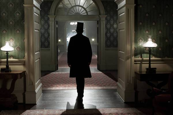"Abraham Lincoln (Daniel Day-Lewis) walks through the corridors of the White House in ""Lincoln."""