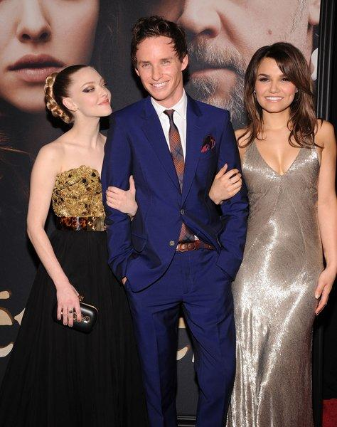 "Amanda Seyfried, left, Eddie Redmayne and Samantha Barks attend the premiere of ""Les Miserables"" at the Ziegfeld Theatre on Monday in New York."
