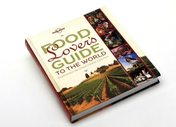 "In his foreword to ""Food Lover's Guide to the World,"" <a class=""taxInlineTagLink"" id=""PECLB00014726"" title=""James Oseland"" href=""/topic/lifestyle-leisure/dining-drinking/james-oseland-PECLB00014726.topic"">James Oseland</a>, editor of <a class=""taxInlineTagLink"" id=""PRDPER000017"" title=""Saveur"" href=""/topic/lifestyle-leisure/dining-drinking/saveur-PRDPER000017.topic"">Saveur</a> magazine, writes, ""For me, there is no better way to understand a place — to literally get it inside you — than by eating its food. Through food, I always find my way."" In the lavishly illustrated pages of this coffee-table tome, you'll find food and drink from a host of countries, recipes (pork <em>vindaloo</em> from India, <em>bibimap</em> from South Korea) and explanations of local foods unique to those places. There's even an entry on California cuisine.<br><br>  Info: $39.99, <a href=""http://www.lonelyplanet.com"">http://www.lonelyplanet.com</a><br><br>  —C.H."