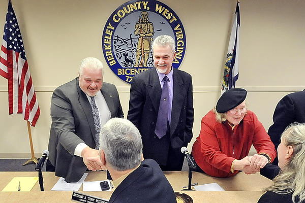 Berkeley County Council members Jim Whitacre, left, Doug Copenhaver and Elaine Mauck are shown in this Herald-Mail file photo. The Berkeley County Council on Thursday agreed in a 4-0 vote to settle a lawsuit by a county employee, who claimed she was wrongfully terminated in October 2011.