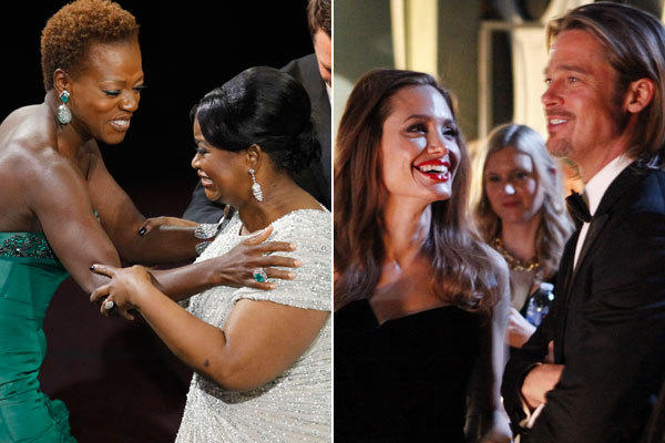 Viola Davis, far left, congratulates Octavia Spencer who won the Oscar for Best Supporting Actress. Angelina Jolie looks at her boyfriend, Brad Pitt, while backstage at the 84th Annual Academy Awards show.