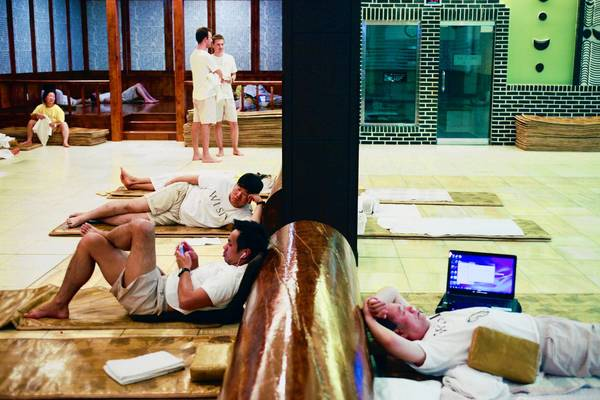 Wi Spa at the edge of Koreatown is a place where immigrants, children of immigrants, local hipsters and more spend the night together on mats after bathing, playing video games, eating and otherwise relaxing.