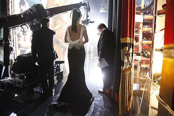 Sandra Bullock prepares to introduce the Best Foreign Film award at the 84th Annual Academy Awards show.