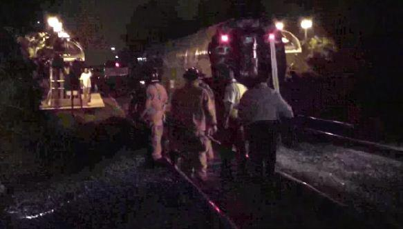 Fire rescue crews search for victim of Amtrak collision with an SUV in Pompano Beach